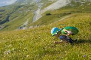 Stock Photo of Italy, Province of Belluno, Veneto, Auronzo di Cadore, little boy crouching on