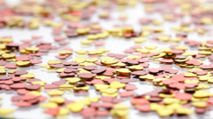 Red and golden hearts confetti - stock footage