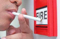 cigarette and fire - stock photo
