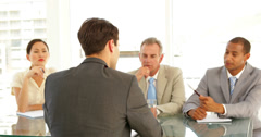 Businessman being interviewed by tough panel - stock footage