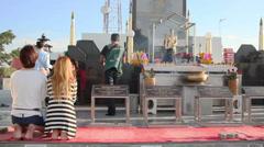 Buddhist Thai people are praying near Big Buddha statue Stock Footage