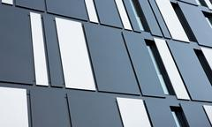 Germany, North Rhine-Westphalia, Aachen, facade of an office building Stock Photos