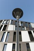 Germany, North Rhine-Westphalia, Aachen, office building and street lamp Stock Photos