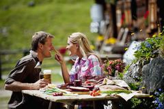 Austria, Salzburg State, Altenmarkt-Zauchensee, couple having an alpine picnic Stock Photos
