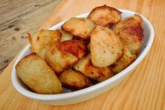 roasties in a serving dish - stock photo