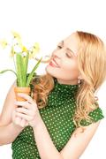 lovely housewife with flower - stock photo