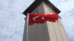 Turkey Flag Waving in the Wind at Koc University Stock Footage