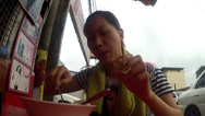 Stock Video Footage of lady press chili and dips piece of bread on mami noodle soup outdoor