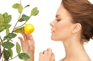 Stock Photo of lovely woman with lemon twig