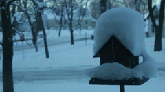 Snowy Bird House to the Right Handheld 01 Stock Footage