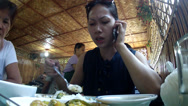 Stock Video Footage of lady eats lunch while calling on cellphone