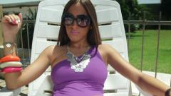 Attractive lady Sunbathing Stock Footage