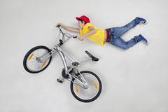 Boy doing stunt on bicycle - stock photo