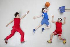 Stock Photo of Boys playing basket ball