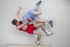 Two men wrestling Stock Photos
