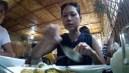Stock Video Footage of lady eats lunch at local bamboo restaurant