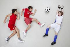 Stock Photo of Boys playing football
