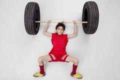 Bay lifting weights Stock Photos