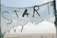 Stock Photo of Gerany, Amrum, Torn net with START inscription