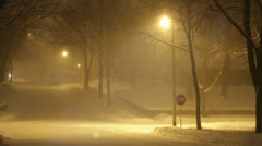 Snowy Neighborhood at Night 01 Stock Footage