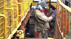 0362 Working with safety equipment Stock Footage