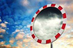 Stock Illustration of weather is changing, dramatic sky in road mirror
