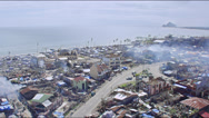 Aerial of coastal city with smoke filled air Stock Footage