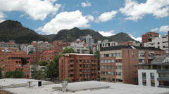 Apartments and mountains of Bogota's Zona Rosa district Stock Footage