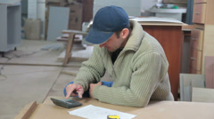 Carpenter calculating layout dimensions Stock Footage