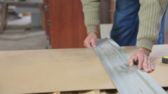 Carpenter cutting wood panel circular saw Stock Footage
