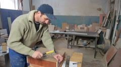 Carpenter using hammer and nail woodworking Stock Footage