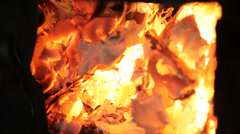 Blazing fire in wood burning stove Stock Footage