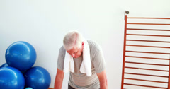 Senior man doing yoga Stock Footage