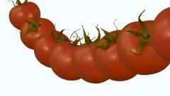 Tomatoes flow with slow motion over white background Stock Footage