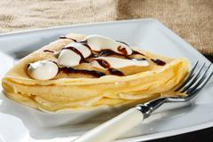 Crepe with whipped cream and chocolate sauce Stock Photos