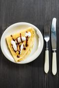 Closeup of chocolate pancakes with whipped cream Stock Photos