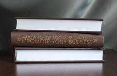 use social media to promote your business. book concept. - stock photo