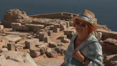 Lindos, Rhodes, Greece. A tourist woman in a hat and sunglasses in Lindos. Stock Footage