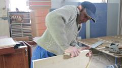 Carpenter manufactures furniture Stock Footage