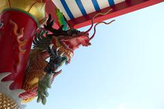 China dragon on oriental temple roof Stock Photos