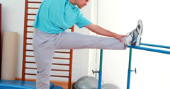 Flexible man stretching his leg Stock Footage