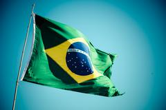 the national flag of brazil (brasil) flutters in the wind - stock photo