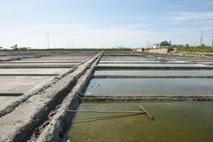 Evaporation ponds of salt farm, portugal Stock Photos
