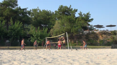 Men playing beach volleyball, team sport, relaxing, vacation Stock Footage