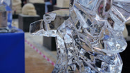 Stock Video Footage of bird ice sculpture at sculpture festival is dripping water
