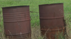Burn barrels tilt up to field Stock Footage