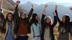 Five Teen Girls Celebrating Outdoors In A Mountain Setting Stock Footage