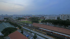 Timelapse of Singapore MRT Subway and Moving Vehicles in Eunos at Sunrise 1080p Stock Footage