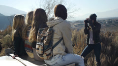 Four Teen Girls Posing For An Outdoor Fall/Winter Picture Taken By A Fifth Stock Footage