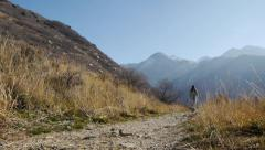 Teen Latina Approaches From A Distance & Passes On A Mountain Trail (Exits Left) Stock Footage